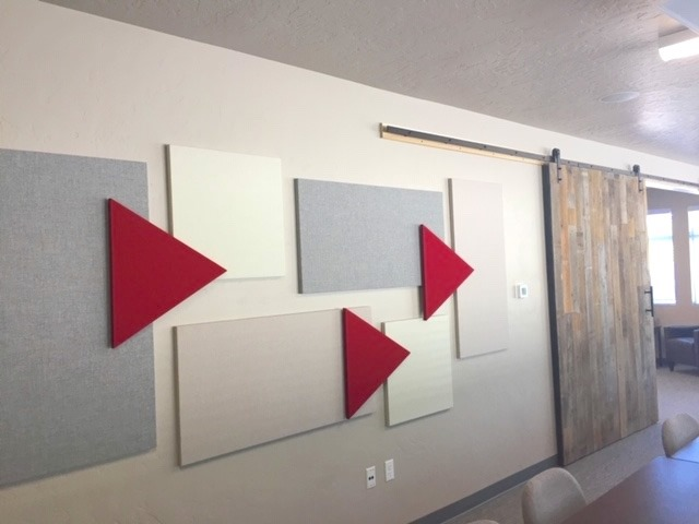 acoustical panels arranged in a pleasing design
